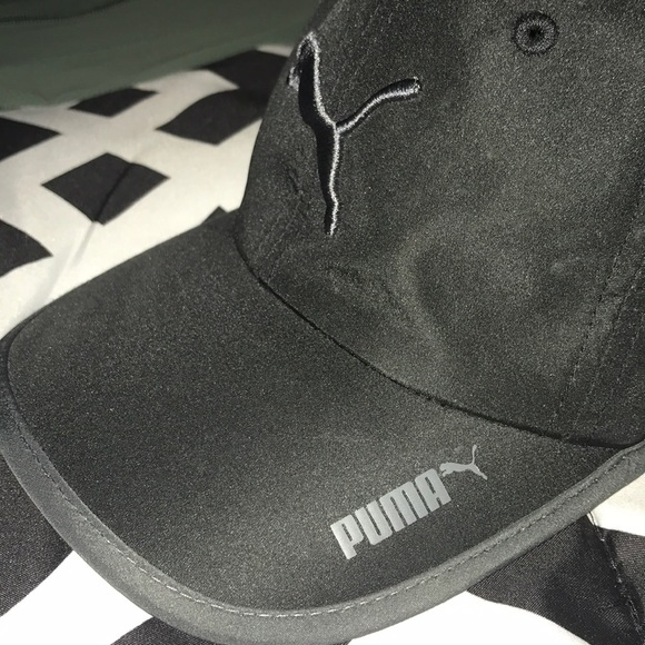 Unisex Puma adjustable athletic hat. M 5b678ffd0cb5aa79e95f0246 7926e1678373